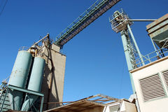 Grain Elevator. Operation against clear blue sky royalty free stock photography