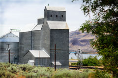 Grain Elevator. A grain elevator to load rail cars in eastern Oregon at Biggs Junction on the Columbia River under gray skies Stock Photo
