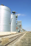 Grain Elevator. A Grain Elevator next to the railroad tracks Royalty Free Stock Photo