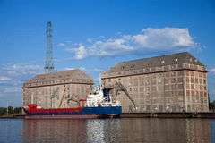 Grain elevator. With terminal and ship in harbour Gdansk, Poland Royalty Free Stock Photo