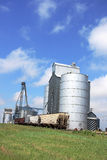 Grain Elevator. Buildings next to railroad track in midwest stock photos
