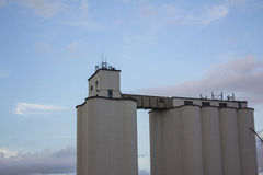 Grain elevator against blue sky Stock Photo