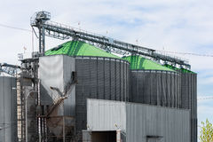 Grain elevator in agricultural zone. Granary with mechanical equipment for receiving, cleaning, drying, grain shipment Stock Photography