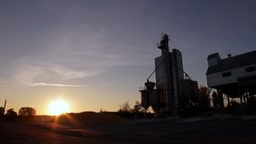 Grain elevator. On the background of beautiful landscape stock video