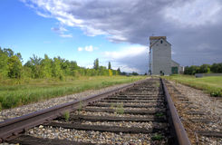 Grain elevator on a Canadian prairie. A grain elevator under s stormy sky in Manitoba, Canada Royalty Free Stock Photos