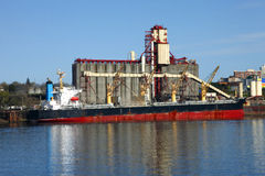 Grain elevator & cargo ship Stock Photography