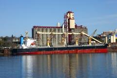 Grain elevator & cargo ship Stock Photography