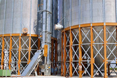 Grain Elevator Detail. Detail of the supporting structure for two grain elevators in the fields of North Carolina. Image shows yellow steel I-beam supports with Stock Images