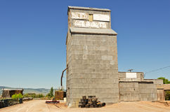 Grain Elevator at End of Road Royalty Free Stock Photography