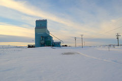 The  Grain Elevator. A lone Grain Elevator stands before an Alberta Chinook Arch Royalty Free Stock Photo