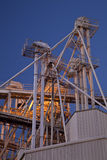 Grain elevator at night. Industrial abstract - top of a grain elevator with gravity flow pipes at night Stock Images