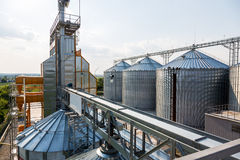 Grain elevator in rural zone. Metal grain elevator in Stock Image