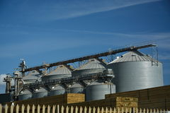 Grain elevator silos and timber Royalty Free Stock Images