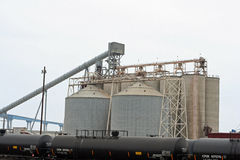 Grain elevator & storage tank. Grain elevator and storage tanks Stock Photos