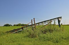 Grain elevator stored in the weeds Stock Photo