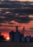 Grain elevator sunset Stock Images