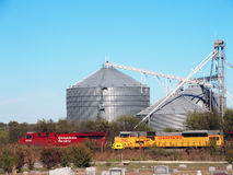 Grain Elevator and Train Locomotives Stock Photography