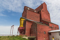 Grain elevator. Weathered grain elevator with peeling paint Stock Images