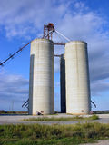 Grain Elevators. Blue skies backdrop the grain elevators and silos in northwestern Oklahoma wheat country Stock Images