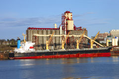 Grain elevators & cargo ship. stock photo