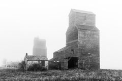 Grain Elevators in the Fog Stock Photo
