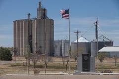 Grain Elevators in the Heartland. Grain silos stand tall in the Heartland Stock Image