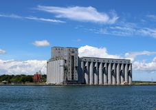 Grain Elevators in Owen Sound. View of the grain bins along at the mouth of the Owen Sound Harbour on a sunny summer day with Georgian Bay water in foreground royalty free stock photo