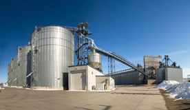 Grain elevators at a shipping port Royalty Free Stock Photos