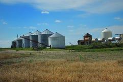 Grain Farm Out Buildings. Grain bins, gas tanks and equipment on Saskatchewan grain farm Stock Photos