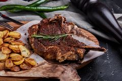 Grain fed Grilled Tomahawk Beef steak with fried potato wedge.  stock images