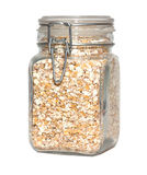Grain flakes in glass jar isolated Royalty Free Stock Photography
