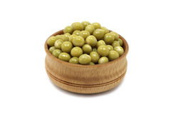 Grain green peas in a wooden bowl Royalty Free Stock Images