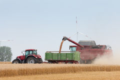 Grain harvest being brought in Royalty Free Stock Photos
