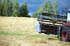 Grain harvester rotary agricultural combine on field after harvest Stock Photos