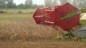 Grain Harvesting, Agriculture - Close Up Harvester Combine Rotor. Prores, Slow Motion stock video footage