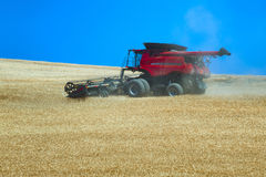 Grain Harvesting. A combine works a hillside harvesting grain in rural Oregon Stock Images