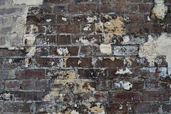 Grain Image of brick stone wall background in detail and texture patte stock photography