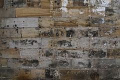 Grain Image of brick stone wall background in detail and texture patte stock image