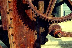 Grain Image: Close up of old machine factory made of steel and used in the past. Broken and rustic machine left over in abandon fa royalty free stock images