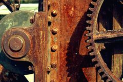 Grain Image: Close up of old machine factory made of steel and used in the past. Broken and rustic machine left over in abandon fa royalty free stock photography