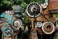 Grain Image: Close up of old machine factory made of steel and used in the past. Broken and rustic machine left over in abandon fa royalty free stock photos