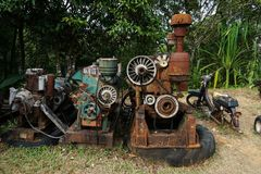 Grain Image: Close up of old machine factory made of steel and used in the past. Broken and rustic machine left over in abandon fa Royalty Free Stock Image