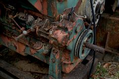 Grain Image: Close up of old machine factory made of steel and used in the past. Broken and rustic machine left over in abandon fa stock photos