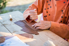 Grain leather. Shoemaker performs shoes in the studio craft Royalty Free Stock Photography