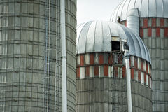 Grain metallic silo. Grain wheat metallic silo on cloudy sky background stock image