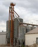 Grain Mill. Against a cloudy sky Royalty Free Stock Image
