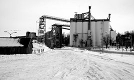A grain mill or factory. In operation during winter Stock Photo
