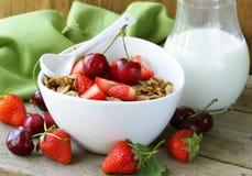 Grain muesli with strawberries and cherries Royalty Free Stock Photo