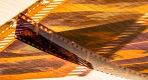 Grain in negative film in color and other avatars. Cinema paradis with the passage of time and the years that endure despite modern technology stock photography