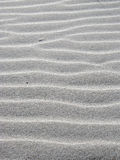 Grain, pattern of sand with waves and ripple lines. Grain, pattern of pure white sand with waves and lines created by shadow and light Royalty Free Stock Photography